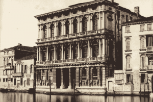 A historic photograph of the Palazzo Rezzonico by the Grand Canal.